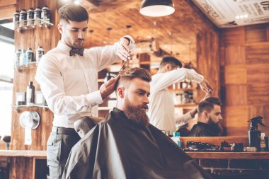 young bearded man with hairdresser