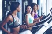 Fotografie young beautiful women  running on treadmill