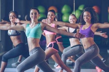 beautiful women in sportswear exercising
