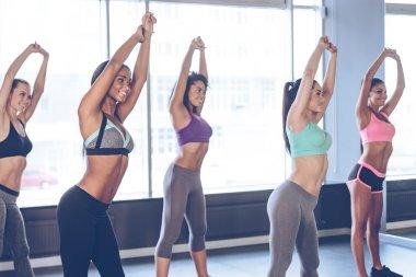 Young beautiful cheerful women doing stretching