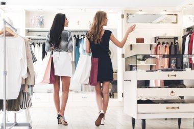 two beautiful women with shopping bags