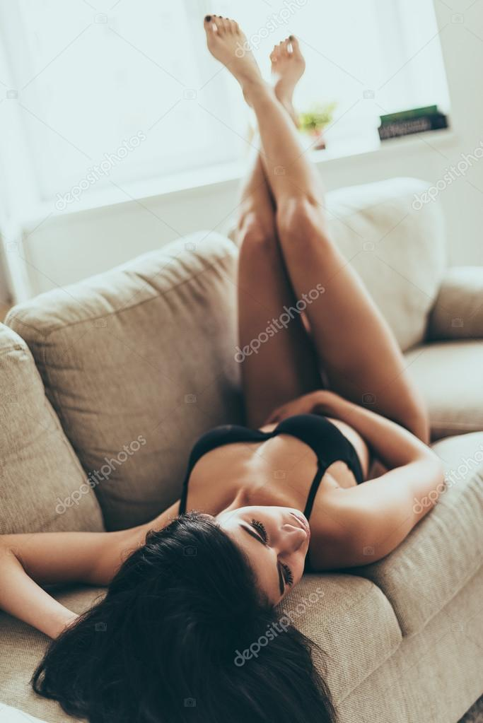 Groovy Woman In Lingerie Lying On Couch Stock Photo Uwap Interior Chair Design Uwaporg