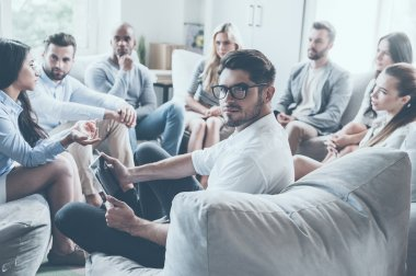 people sitting in circle and discussing something