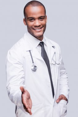 African doctor stretching out hand for shaking