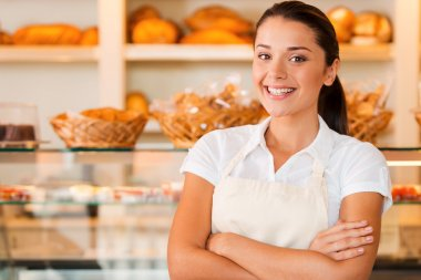 Woman in apron in bakery shop