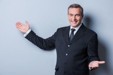 Cheerful mature man in formalwear