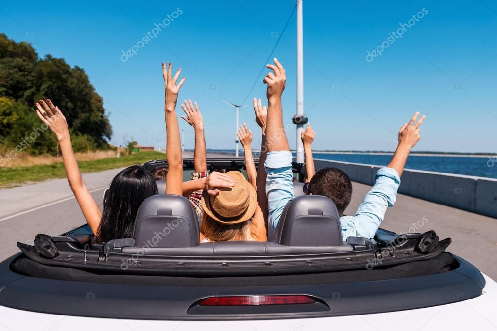 People enjoying road trip