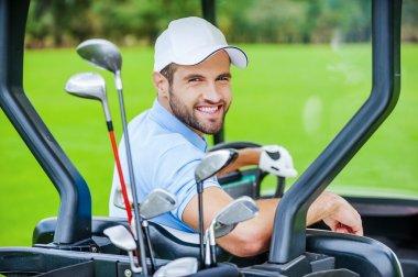 Golfer in golf car