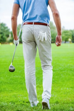 Golfer walking