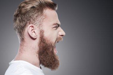 Young bearded man shouting