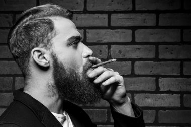 Young bearded man smoking