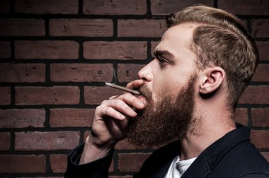 Bearded man smoking a cigarette