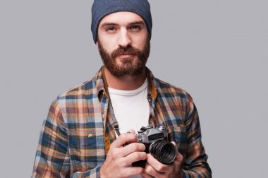 Bearded man holding old-fashioned camera
