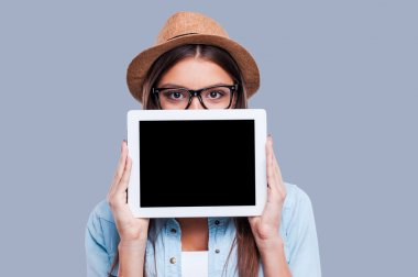 Young woman with her digital tablet.
