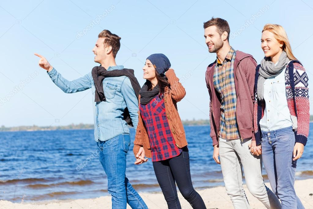 Young couples walking by the beach
