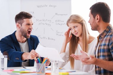 Furious boss shouting  on business people