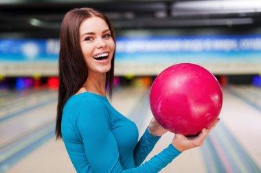 Woman holding bowling ball
