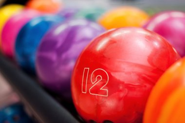 Bowling balls lying in the rows