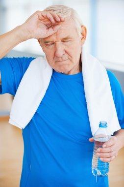 Tired senior man in health club