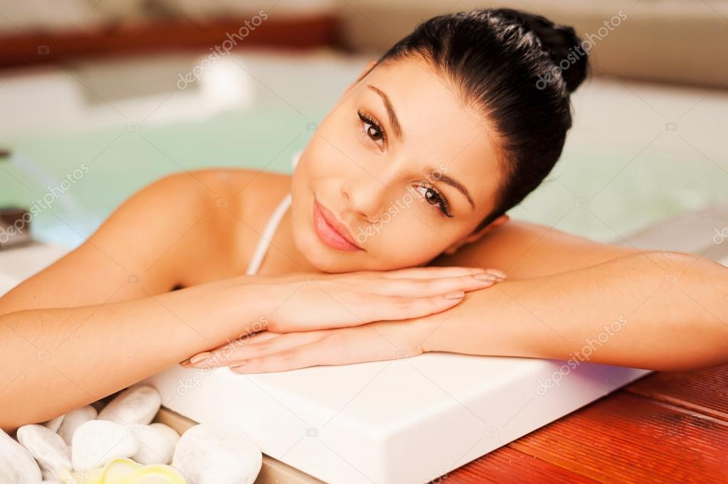 Woman relaxing in hot tub