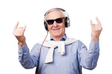 Cheerful senior man in headphones