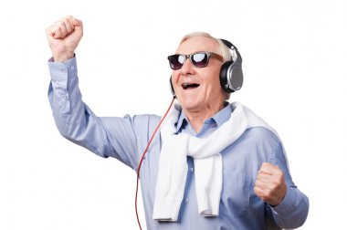 Cheerful senior man in headphones