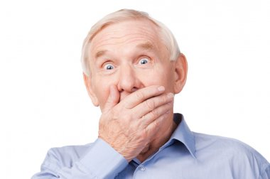 Senior man covering mouth with hand