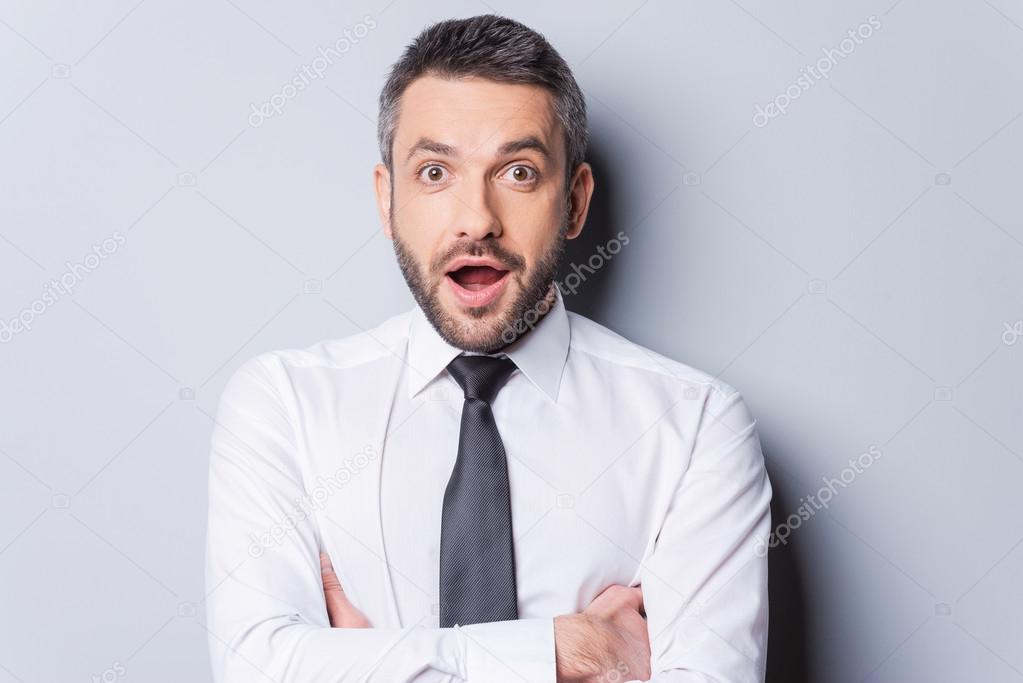 Surprised mature man in shirt and tie