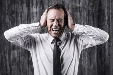 Stressed mature man in shirt  shouting