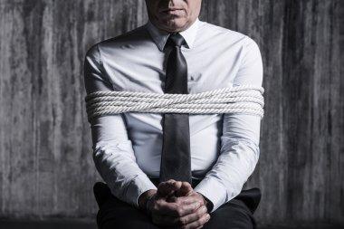 Tied up businessman
