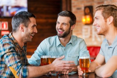 Young men  talking and drinking beer
