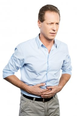 Mature man touching his stomach
