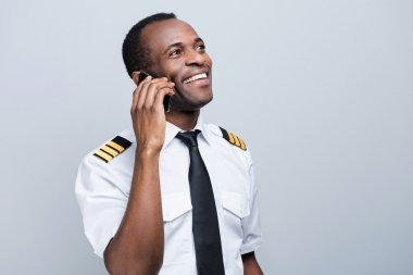African pilot holding mobile phone