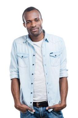 Black man holding hands in pockets