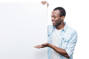 Black man pointing at the copy space