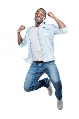 Young black man jumping