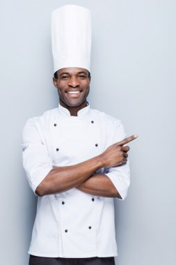 African chef  pointing away