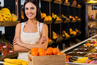 Smiling woman standing in grocery store