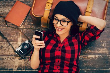 Woman holding mobile phone and smiling