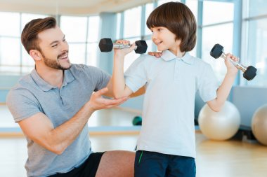 Father with son in health club