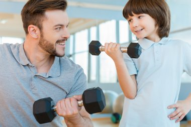 Father and son in health club