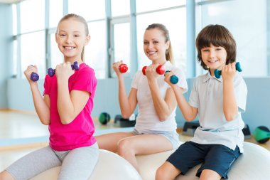Mother and two children in health club