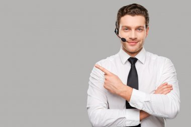 Man in headset pointing away