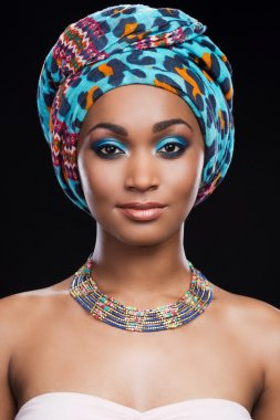African woman wearing headscarf and necklace
