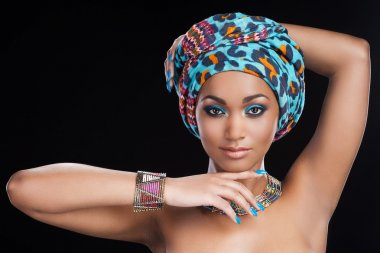 African woman in headscarf and jewelry