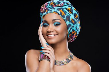 African woman wearing headscarf and jewelry