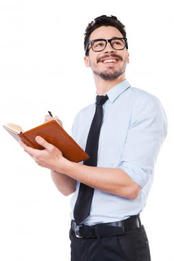 Young man in shirt making notes