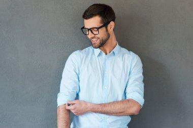Man in shirt adjusting sleeves