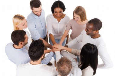 Group of people keeping hands clasped