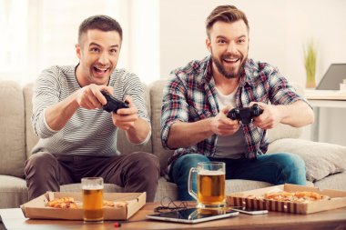 Happy men playing video games